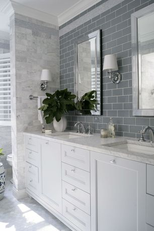 Traditional Master Bathroom with Complex marble counters, Crown molding, White Bianco Carrera 3x6 Marble Subway Tile Honed