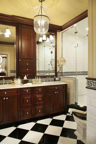 Traditional Master Bathroom with Vinyl floors, Raised panel, Carrara bianco polished greek key mosaic marble border