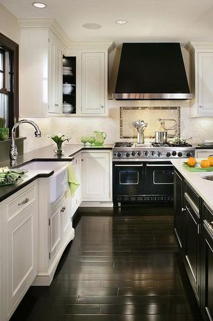Traditional Kitchen with Built-in speakers, Custom hood, Quartz Tile, Flat panel cabinets, Undermount sink, Farmhouse sink