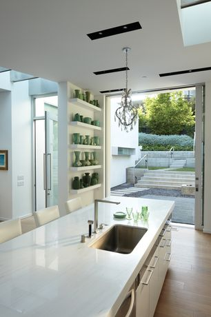 Contemporary Kitchen with Simple marble counters, can lights, Paint 1, Breakfast bar, Undermount sink, Standard height, Flush