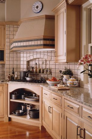 Country Kitchen with Simple granite counters, Stone Tile, L-shaped, Inset cabinets, High ceiling, Custom hood, Limestone Tile