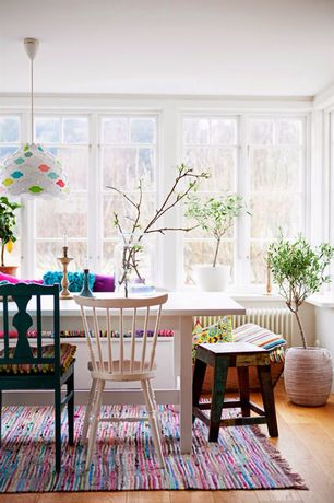 Eclectic Dining Room with Crown molding, Window seat, Hardwood floors, Pendant light