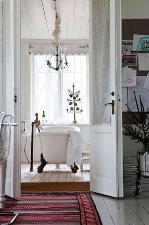 Cottage Master Bathroom with Mid century italian wrought iron & crystal distressed black & silver chandelier, Hardwood floors