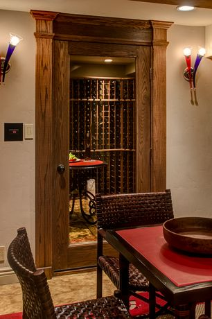 Craftsman Wine Cellar with Standard height, Built-in bookshelf, can lights, Wall sconce, Laminate floors, French doors