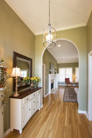 Traditional Hallway with Hardwood floors, Standard height, Crown molding, Chandelier
