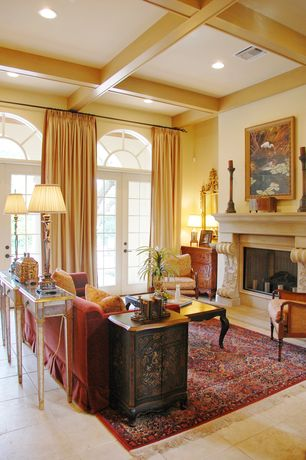 Traditional Living Room with Standard height, can lights, Fireplace, limestone tile floors, Arched window, French doors