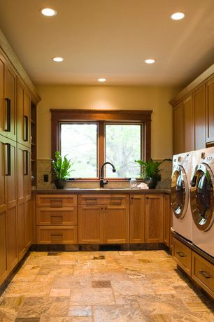Craftsman Laundry Room with slate tile floors, Undermount sink, Built-in bookshelf