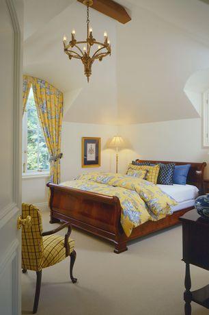 Traditional Master Bedroom with Standard height, Carpet, specialty door, Casement, Chandelier, Exposed beam