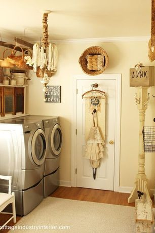 Country Laundry Room with Crown molding, Undermount sink, specialty door, Built-in bookshelf, Laminate floors