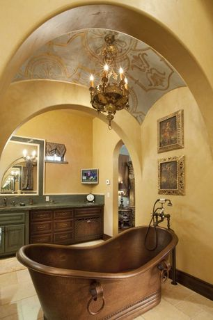 Mediterranean Master Bathroom with Limestone counters, Freestanding, Undermount sink, Inset cabinets, Raised panel, Limestone