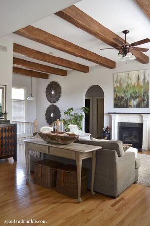 Traditional Living Room with Ceiling fan, Hardwood floors, Exposed beam, Pendant light, Cement fireplace