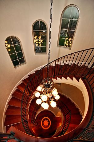 Traditional Staircase with Arched window, Hardwood floors, Chandelier, Cathedral ceiling