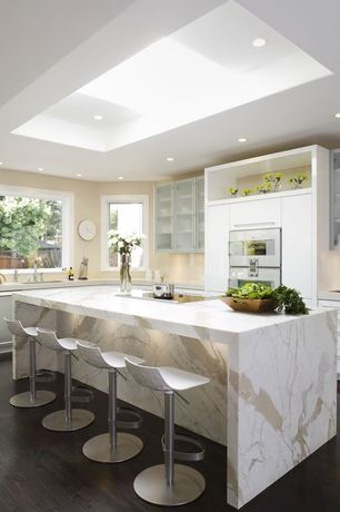 Contemporary Kitchen with Kitchen island, White kitchen cabinets, Waterfall countertop, dishwasher, L-shaped, Breakfast bar