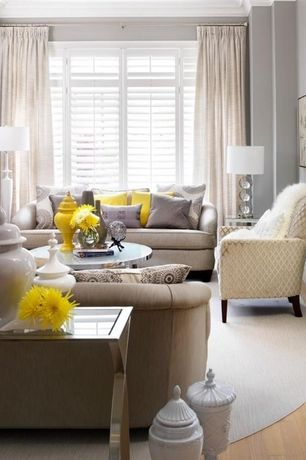 Traditional Living Room with Plantation shutters, Global Views Beaufort Decorative Urn, Crown molding, Hardwood floors