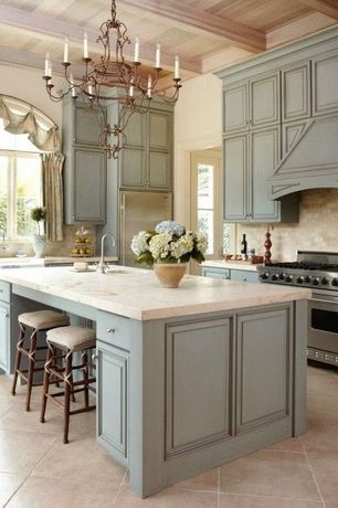 Traditional Kitchen with Stone Tile, Complex granite counters, Flush, Chandelier, Breakfast bar, Limestone Tile, Custom hood