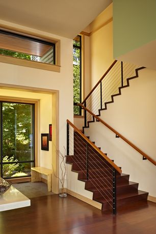 Contemporary Staircase with Cable railing system with wooden handrail, Cathedral ceiling, Crown molding, Hardwood floors