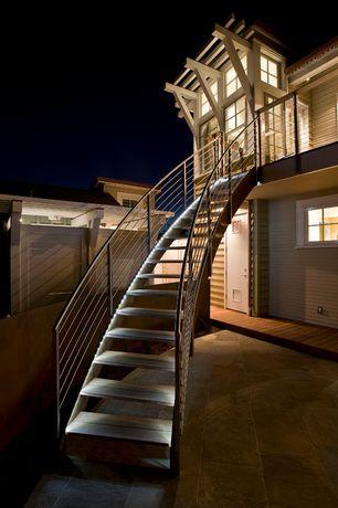 Modern Staircase with sandstone tile floors, specialty door