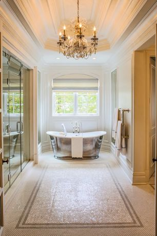 Traditional Master Bathroom with Casement, frameless showerdoor, Freestanding, specialty door, Chandelier, penny tile floors