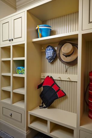 Traditional Mud Room with soapstone tile floors, General Tools 3-1/2 in. Shaker Pegsv, Built-in bookshelf, Crown molding