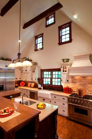 "Country Kitchen with Built In Refrigerator, double-hung window, Multiple Sinks, Viking - 30"" gas cooktop - vgc, Stone Tile"