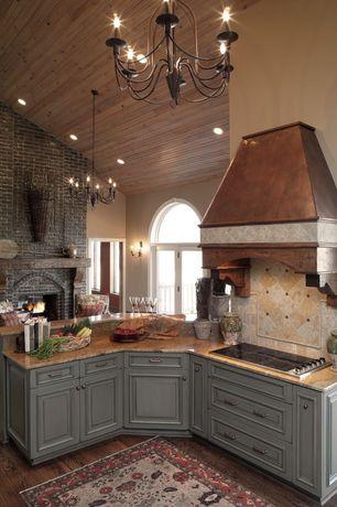 Country Kitchen with Premier Copper Euro Range Hood, Limestone Tile, Hardwood floors, Flush, Raised panel, Stone Tile