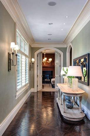 Traditional Hallway with Interior window shutters, Wood parquet floor, Crown molding, Casement, six panel door, Paint