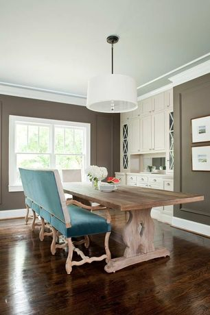 Contemporary Dining Room with Paint 1, Standard height, Built-in bookshelf, Chandelier, flush light, Crown molding, Paint 2