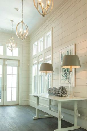 Cottage Entryway with French doors, Crown molding, Transom window, Hardwood floors, Clear glass tapered table lamp