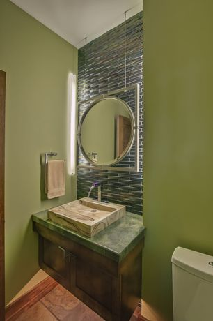 Modern Powder Room with Flat panel cabinets, Ceramic Tile, Standard height, stone tile floors, Vessel sink, Flush