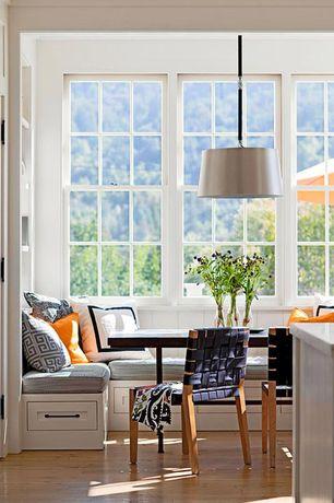 Contemporary Dining Room with Pendant light, Standard height, Transom window, specialty door, Window seat, Built-in bookshelf