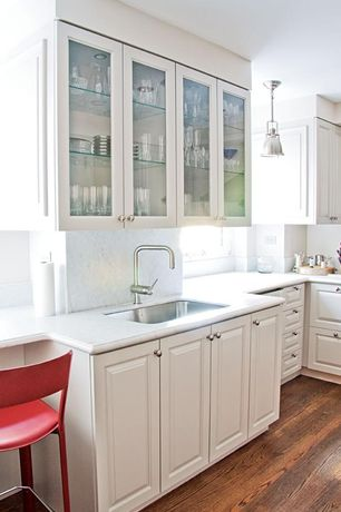 Traditional Kitchen with Undermount sink, Simple marble counters, Simple Marble, Flat panel cabinets, Glass panel, L-shaped