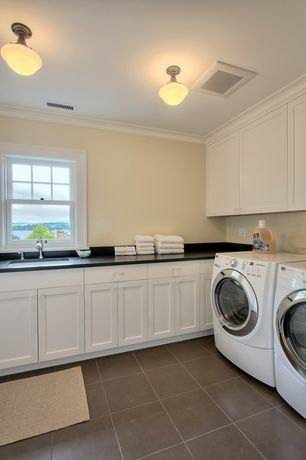 Traditional Laundry Room with Standard height, Crown molding, laundry sink, double-hung window, terracotta tile floors