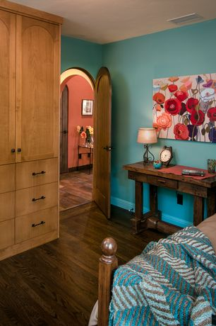 Eclectic Guest Bedroom with Hardwood floors, Arch door, Paint 2, Art desk, Four poster bed, Built-in bookshelf, Paint 1
