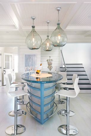 Contemporary Dining Room with Laminate floors, Pendant light, Box ceiling