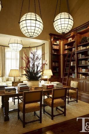 Traditional Library with Built-in bookshelf, Pendant light, Cathedral ceiling, Hardwood floors