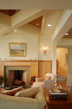 Traditional Living Room with Fireplace, Wall sconce, Standard height, Cement fireplace, Exposed beam, Hardwood floors