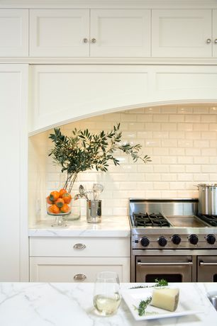 Traditional Kitchen with Complex marble counters, Flush, Subway Tile, Flat panel cabinets, Custom hood, One-wall