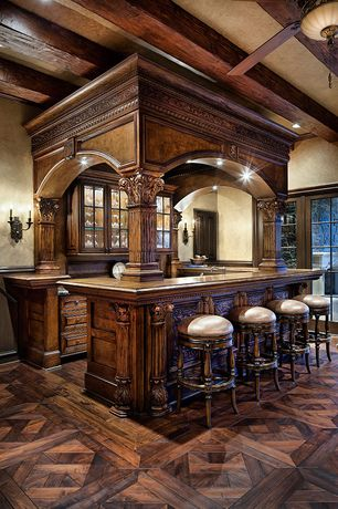 Traditional Bar with Crown molding, Wall sconce, Wainscotting, picture window, Standard height, Ceiling fan, Columns