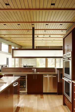 Contemporary Kitchen with Heath Ceramics Classic Made-to-Order Field Tile, Kitchen island, Bover Tekno Lp2 Suspension Light