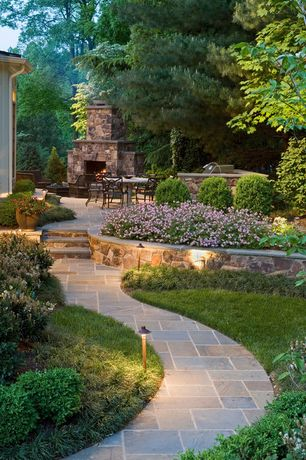 Traditional Landscape/Yard with Fieldstone Rock Garden Wall, exterior tile floors, Raised beds, Fountain, Pathway