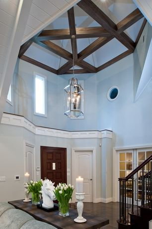 Traditional Entryway with Exposed beam, Cathedral ceiling, Pendant light, complex marble tile floors