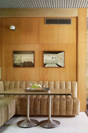 Contemporary Dining Room with Standard height, Wall sconce, sandstone floors
