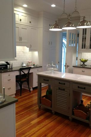 Country Kitchen with Soapstone counters, 2 in. Solid Surface Countertop in Bronzite, Pendant light, Simple marble counters