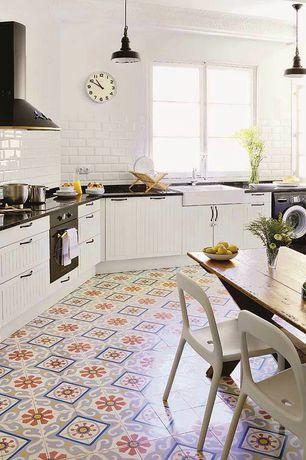 Eclectic Kitchen with European Cabinets, Farmhouse sink, Quartz countertop, Subway Tile, Mexican tile, Breakfast nook