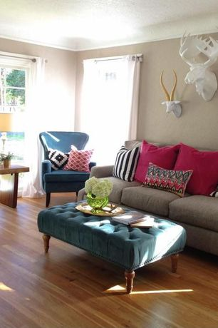 Eclectic Living Room with White Moose Head, Crown molding, Goldie The Wall Hanging Ram, Marcelle Tufted Ottoman