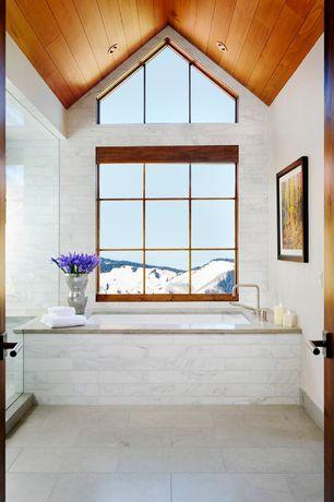 Contemporary Master Bathroom with complex marble tile floors, Master bathroom, specialty door