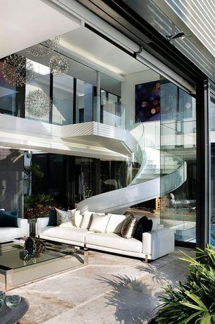 Modern Great Room with Glass railing, French doors, Chandelier, Indoor/outdoor living, complex marble tile floors, Loft