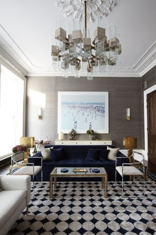 Eclectic Living Room with Tufted blue velvet sofa, Chandelier, Built-in bookshelf, specialty door, Hardwood floors