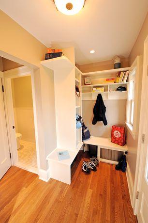 Traditional Mud Room with Hardwood floors, Hampton bay 2-light oil-rubbed bronze flush mount, Glass panel door, flush light
