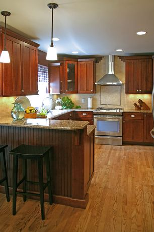 Craftsman Kitchen with Glass panel, Flush, Breakfast bar, Undermount sink, Armstrong Flooring - Northern Red Oak in Natural